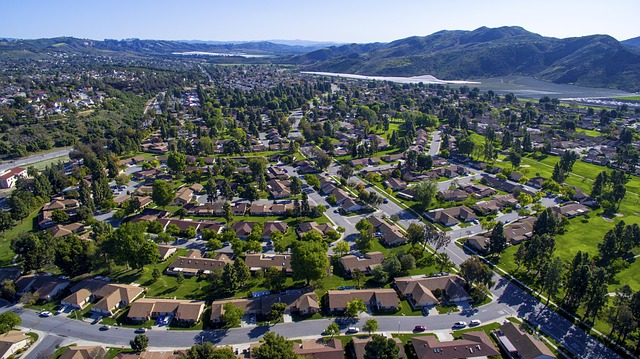 Aerial drone picture of a urban community close to mountains